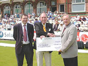 At Old Trafford, presenting a cheque for £100,000 to the Chairman of Lancashire C.C.C.